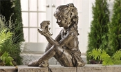 Sitting Girl with Fairy Figurine